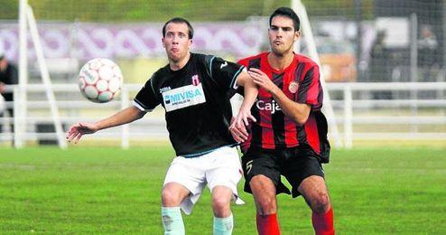 En la imagen, el ursaonense Manuel Palop, en un lance del Triana-Osuna de la primera vuelta de Liga.