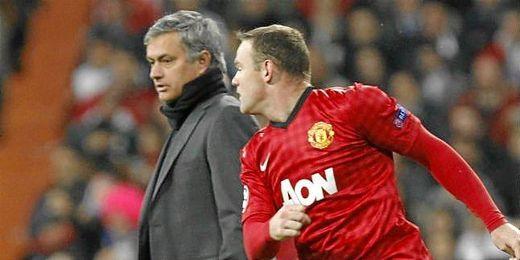 Rooney y Mourinho durante el partido de octavos de la Champions League.