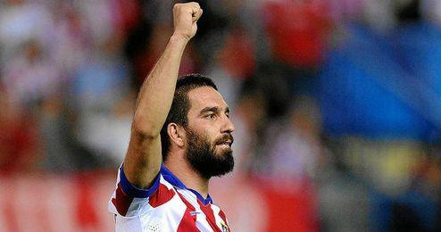 Arda Turan celebra un gol con el Atlético en Champions.