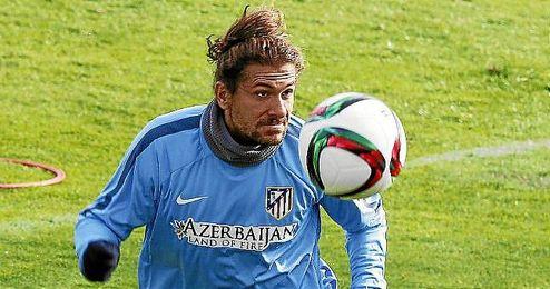 Cerci en un entrenamiento con el Atlético.