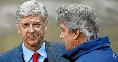 Arsene Wenger junto a Pellegrini.