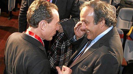 Platini, en un acto p�blico de la RFEF con Butrague�o.