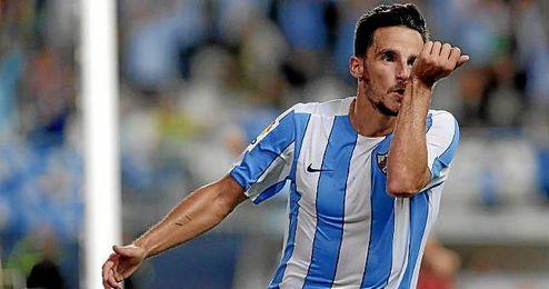 Juankar celebra un gol con el Málaga.