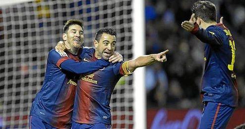Xavi y Messi celebrando un gol con el FC Barcelona.