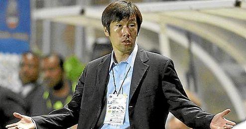 Gao Hongbo durante un encuentro