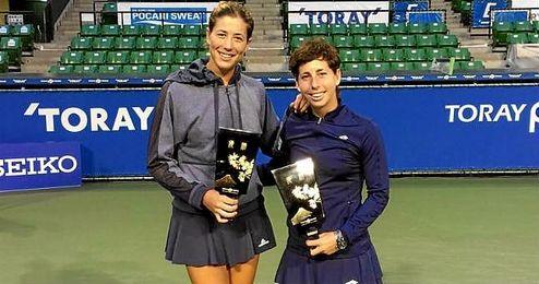 En la imagen, las tenistas españolas Muguruza y Suárez.