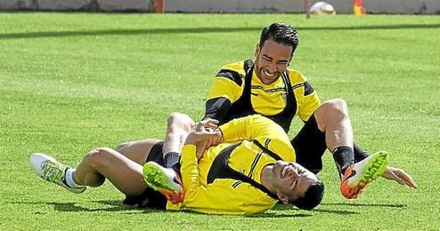 Rami y Vitolo, en una sesi�n en Cartaya.