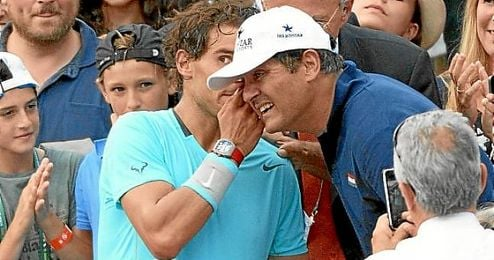 Toni Nadal, junto a Rafa en un torneo.