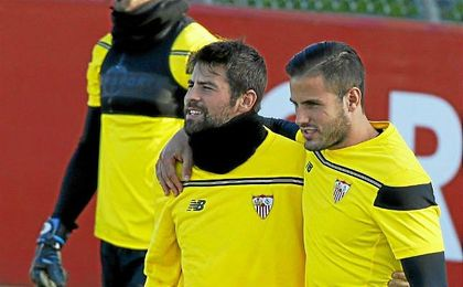 Luismi, junto a Coke en un entrenamiento del Sevilla.