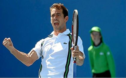 Guillermo Garc�a-L�pez celebra un punto en el US Open.