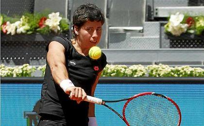 Carla Su�rez golpea una bola durante el Madrid Open.