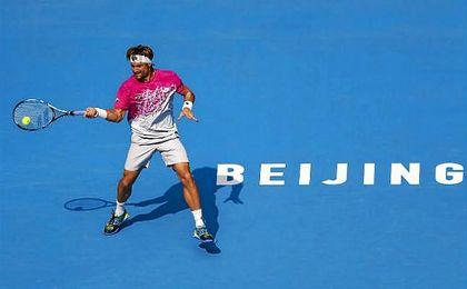 Los españoles David Ferrer y Garbiñe Muguruza pasan de ronda en el Open de China.