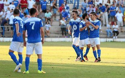 Los jugadores del Écija celebran un gol en el partido ante el Olímpic de Xátiva.