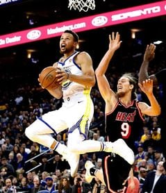 95-123. Curry y Durant se exhibieron ante Heat y Warriors