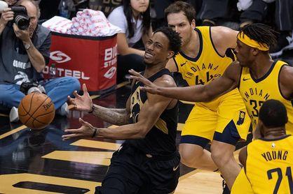 Los Raptors ganan el titulo de la División Atlántico; los Sixers el duelo a Cavaliers