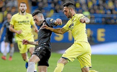 Munir y Álvaro, en un lance del partido.