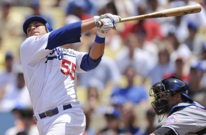 2-1. Martin remolca las dos carreras de los Dodgers en su triunfo sobre los Cardenales