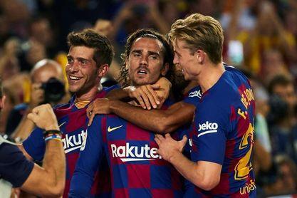 Griezmann rescata al Barça, Vitolo al Atlético y el Sevilla líder