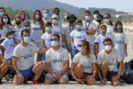 Dos medallistas y un diploma en Tokio limpian un arenal de Porto do Son